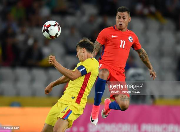 Eduardo Vargas of Chile vies for the ball with Vlad Chiriches of Romania during their international friendly football match between Romania and Chile...