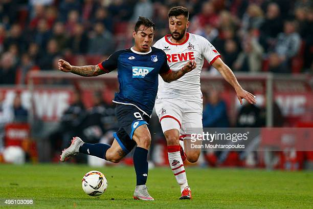 Eduardo Vargas of Hoffenheim battles for the ball with Dominic Maroh of koeln during the Bundesliga match between 1 FC Koeln and TSG 1899 Hoffenheim...
