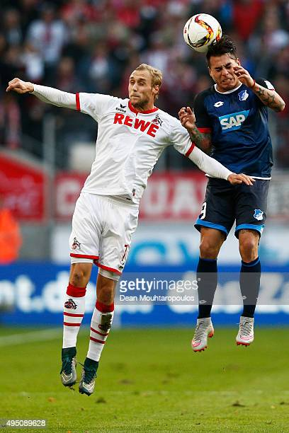Eduardo Vargas of Hoffenheim challenges for the headed ball with Marcel Risse of koeln during the Bundesliga match between 1 FC Koeln and TSG 1899...