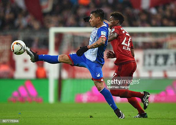 Eduardo Vargas of Hoffenheim controls the ball from David Alaba of Bayern Munich during the Bundesliga match between FC Bayern Muenchen and 1899...