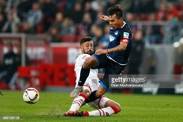 Eduardo Vargas of Hoffenheim is tackled and fdouled by Dominic Maroh of koeln during the Bundesliga match between 1 FC Koeln and TSG 1899 Hoffenheim...