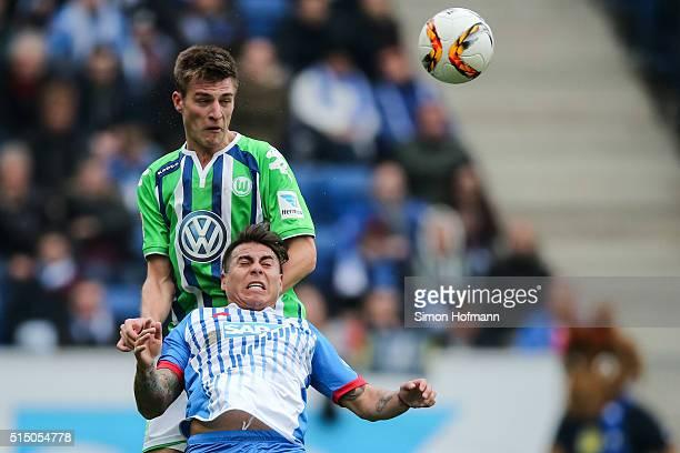 Eduardo Vargas of Hoffenheim jumps for a header with Robin Knoche of Wolfsburg during the Bundesliga match between 1899 Hoffenheim and VfL Wolfsburg...