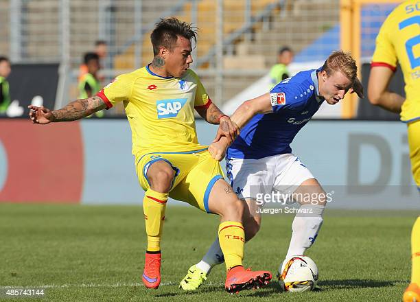 Eduardo Vargas of Hoffenheim tackles Fabian Holland of Darmstadt during the Bundesliga match between SV Darmstadt 98 and 1899 Hoffenheim at...