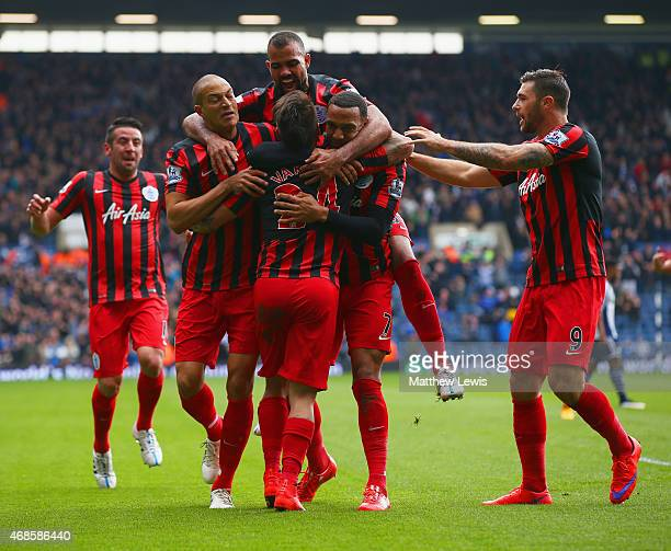 Eduardo Vargas of QPR is congratulated by team mates on scoring the opening goal during the Barclays Premier league match West Bromwich Albion and...