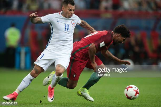 Eduardo Vargas of the Chile national football team and Eliseu of the Portugal national football team vie for the ball during the 2017 FIFA...