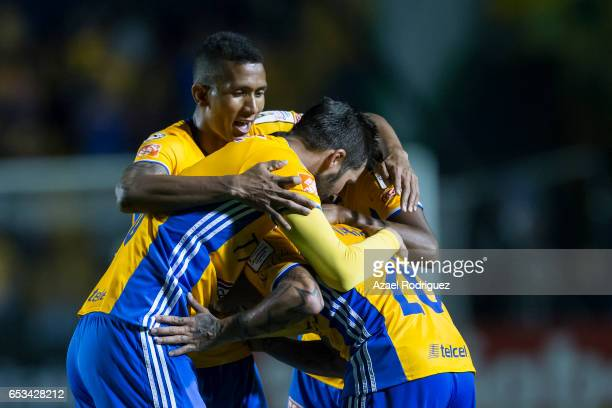 Eduardo Vargas of Tigres celebrates with teammates after scoring his team's second goal during the semifinals first leg match between Tigres UANL and...