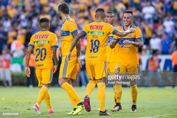 Eduardo Vargas of Tigres celebrates with teammates after scoring his team's first goal during the 5th round match between Tigres and Pumas as part of...