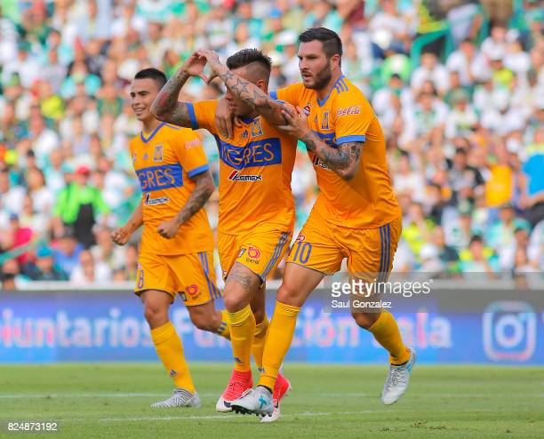 Eduardo Vargas of Tigres celebrates with teammates after scoring the first goal of his team during the 2nd round match between Santos Laguna and...