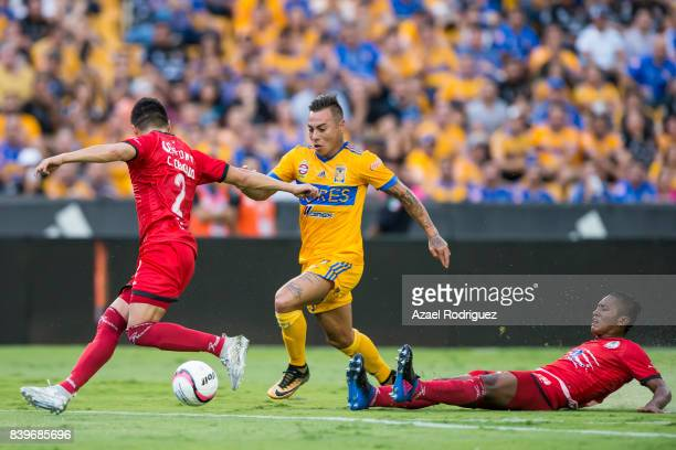 Eduardo Vargas of Tigres fights for the ball with Cesar Cercado and Pedro Aquino of Lobos during the seventh round match between Tigres UANL and...