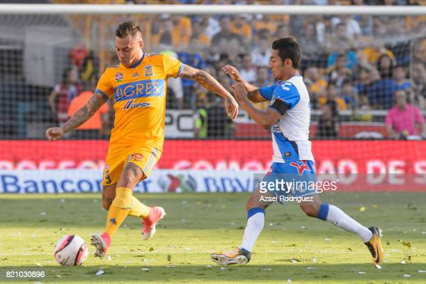 Eduardo Vargas of Tigres fights for the ball with Jose Toledo of Puebla during the 1st round match between Tigres UANL and Puebla as part of the...