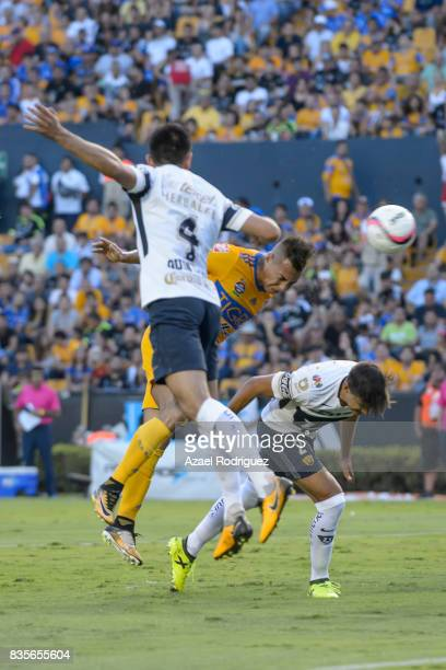 Eduardo Vargas of Tigres heads the ball to score his team's first goal during the 5th round match between Tigres and Pumas as part of the Torneo...