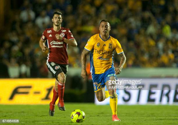 Eduardo Vargas of Tigres vies for the ball with Guido Rodriguez of Tijuana during the Mexican Clausura 2017 tournament football match at the...