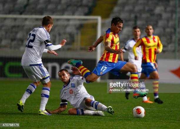 Eduardo Vargas of Valencia CF jumps to take control of the ball oduring the Europa League Round of 16 match between FC Dynamo Kyiv and Valencia CF on...