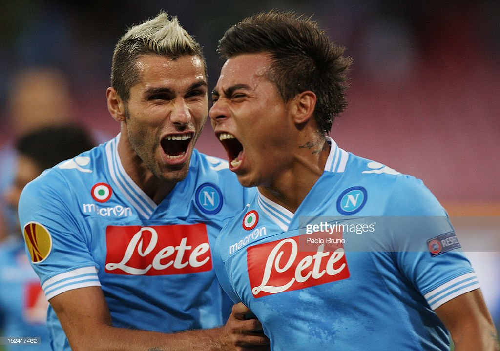 Eduardo Vargas with his teammate <a gi-track='captionPersonalityLinkClicked' href=/galleries/search?phrase=Valon+Behrami&family=editorial&specificpeople=453450 ng-click='$event.stopPropagation()'>Valon Behrami</a> of SSC Napoli celebrate after scoring the opening goal during the UEFA Europa League group F match between SSC Napoli and AIK Solna on September 20, 2012 in Naples, Italy.