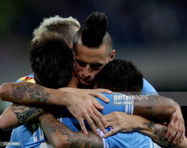 Eduardo Vargas with his teammates of SSC Napoli celebrates after scoring his second team's goal during the UEFA Europa League group F match between...