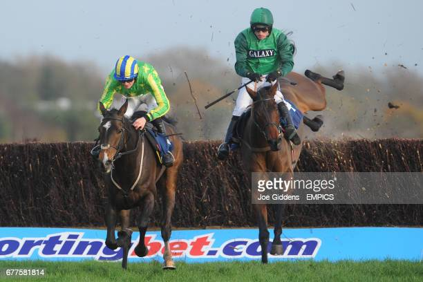 Educated Evans ridden by Sam TwistonDavies clears the last fence and goes on to win The Silver E/Sanderson Weatherall Novices' Handicap Steeple Chase...