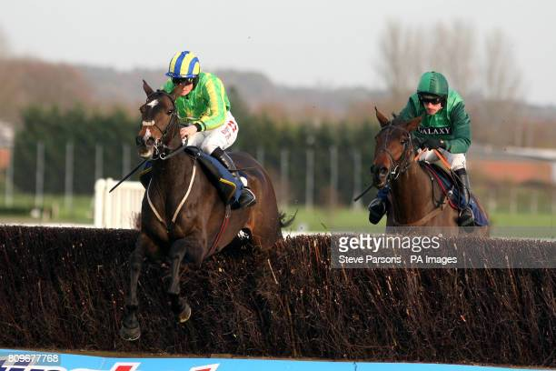 Educated Evans ridden by Sam TwistonDavies wins the Silver E/Sanderson Weatherall Novices Handicap Steeple Chase during Gentlemen's Day of The...