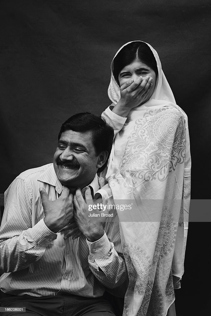 Education activist <a gi-track='captionPersonalityLinkClicked' href=/galleries/search?phrase=Malala+Yousafzai&family=editorial&specificpeople=5849423 ng-click='$event.stopPropagation()'>Malala Yousafzai</a> is photographed with her father Ziauddin Malala for People magazine on August 30, 2013 in Birmingham, England.