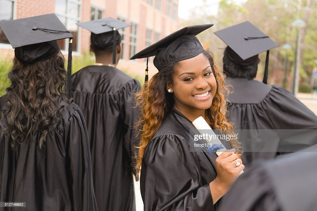 Education: African descent female graduate and friends on college campus. : Stock Photo