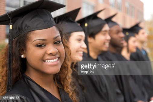 Education: African descent graduate and friends on college campus.
