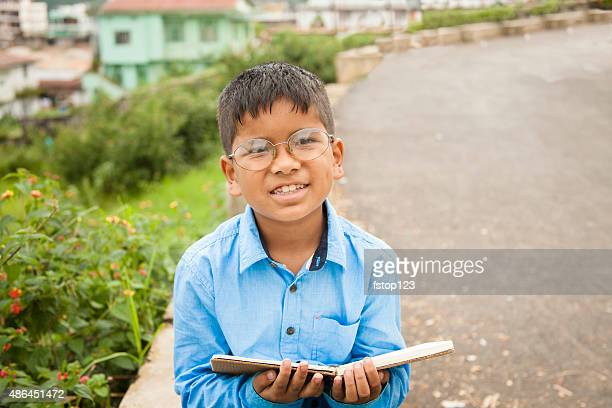 Education. Children. Little boy living in India ready for school.