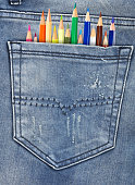 Jeans with pencils in back-pocket