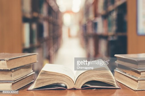 Education concept with old book in library : Stock Photo