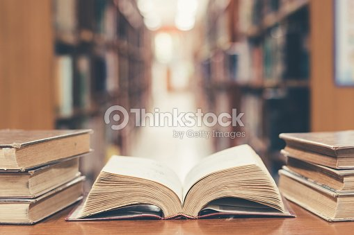 Education concept with old book in library : Foto stock