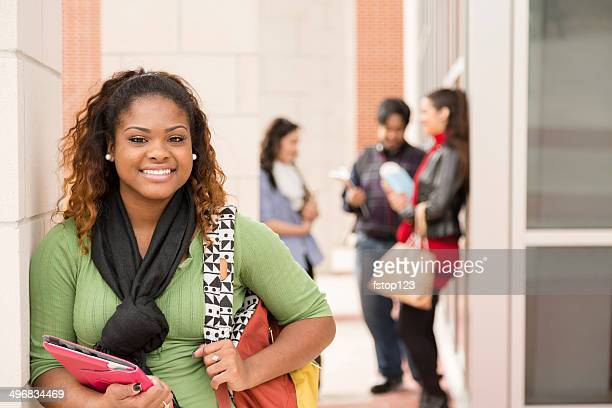 Education: Confident, African descent female college student on campus.