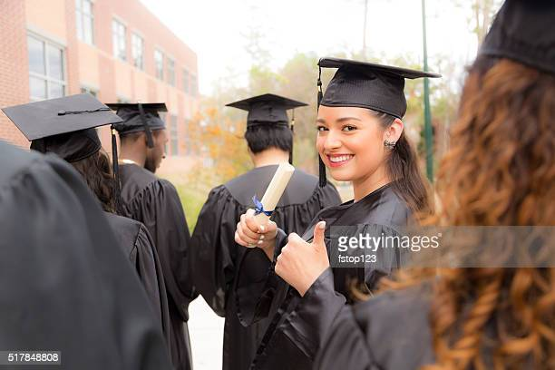 Education: Female graduate and friends on college campus.