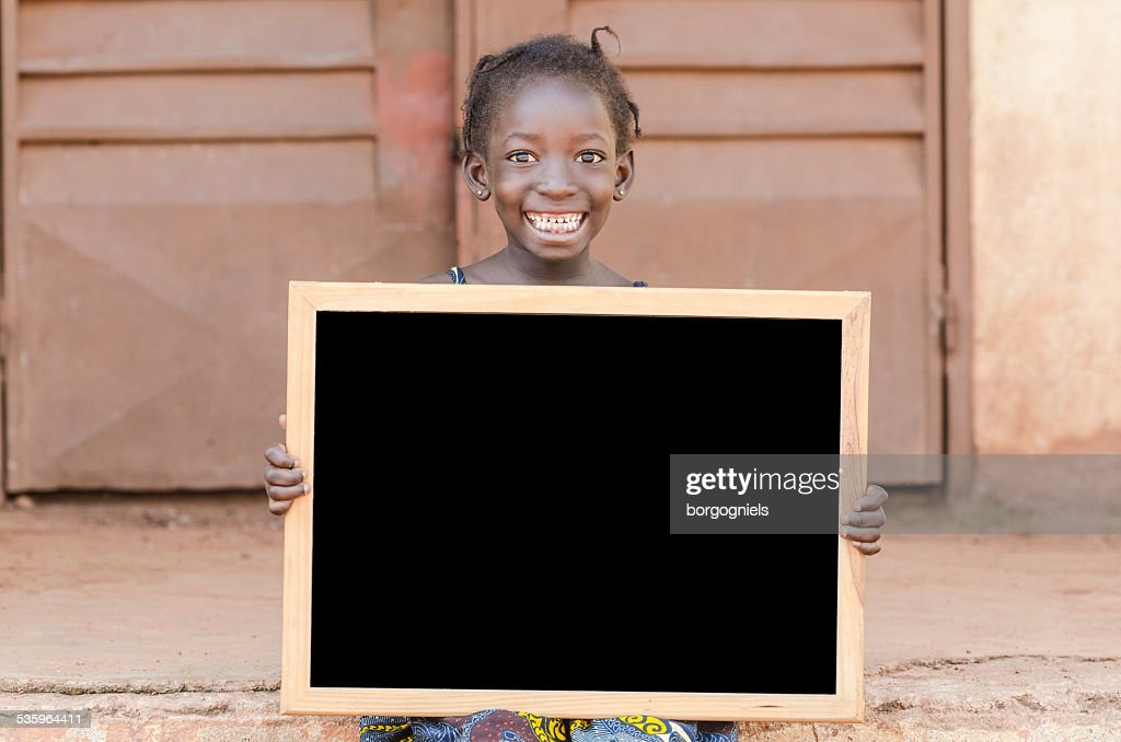 Education for African Children: Young Bambara Ethnicity Girl Holding Blackboard : Stock Photo