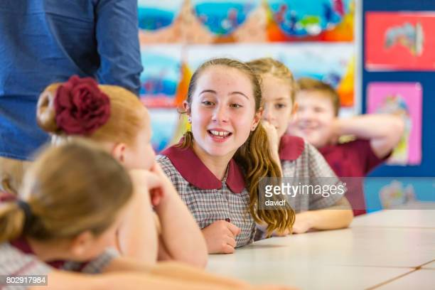 Education Girl Answering a Question in Class