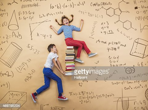 Education image of two schoolchildren on a math background : Stock Photo
