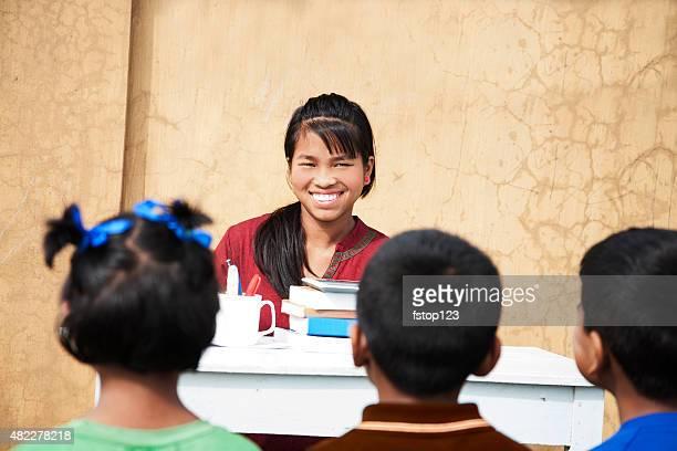 Education. Indian descent children at school. Outdoor classroom.
