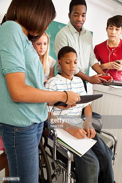 Education: Math students, teacher. School, classroom. Technology, disability.
