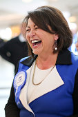 Education Minister Hekia Parata enjoys a laugh during a walkabout as Key begins his two days on the road for the National Party Bus Trip at...