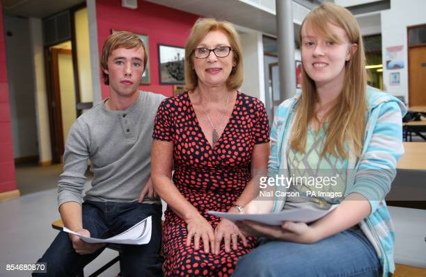 Education minister Jan O'Sullivan with students Evan Kelly and Kate McDonnell who have received their leaving certificate results at St Nessan's...