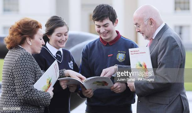 Education Minister Ruairi Quinn and Junior Minister at the Dept of Health Kathleen Lynch with Mihai Cadere from O'Connell's School Dublin and Nadine...