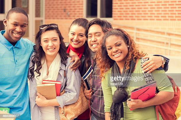 Education: Multi-ethnic college friends hang out before class.