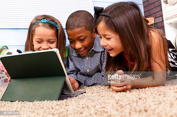 Education:  Multi-ethnic Elementary 7-8 year olds digital tablet