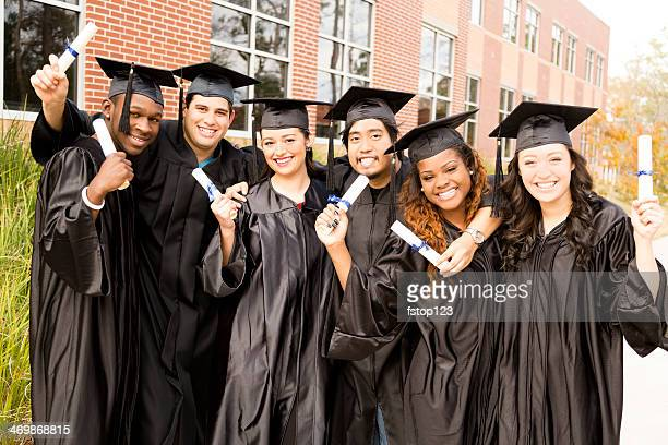 Education: Multi-ethnic friends excited after college graduation.