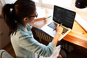 Young female programmer working at home.