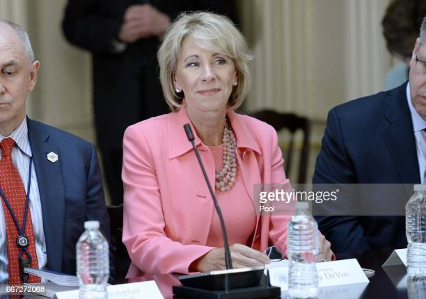 Education Sec Betsy DeVos listens as US President Donald Trump speaks during a strategic and policy discussion with CEOs in the State Department...
