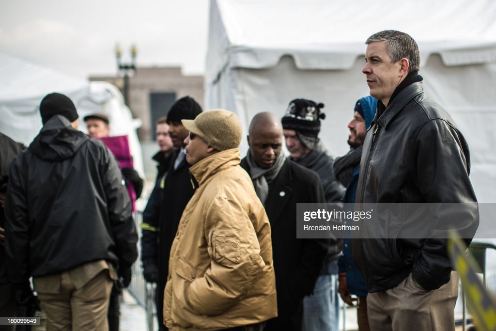 Education Secretary Arnie Duncan waits his turn to speak in favor of stricter gun control laws during a rally on the National Mall on January 26, 2013 in Washington, DC. Demonstrators included survivors of the shooting at Virginia Tech, Newtown, Connecticut, and others.