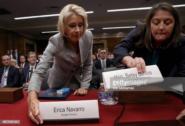 Education Secretary Betsy DeVos and Erica Navarro exchange name plates prior to testifimony before the Senate Appropriations Committee on Capitol...