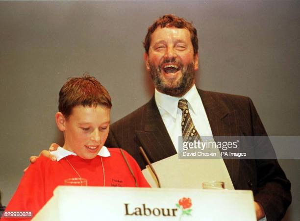 Education Secretary David Blunkett applauds 11yearold Charlie Nobbs making an address to the conference at Brighton today Photo by David Cheskin/PA