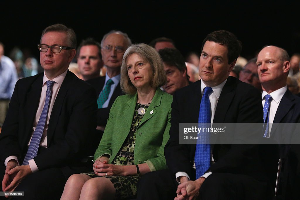 Education Secretary Michael Gove (L), Home Secretary Theresa May (C) and Chancellor George Osborne (2nd R) listen to British Prime Minister David Cameron deliver his keynote speech on the last day of the annual Conservative Party Conference at Manchester Central on October 2, 2013 in Manchester, England. During his closing speech David Cameron will say that his 'abiding mission' would make the UK into a 'land of opportunity'.