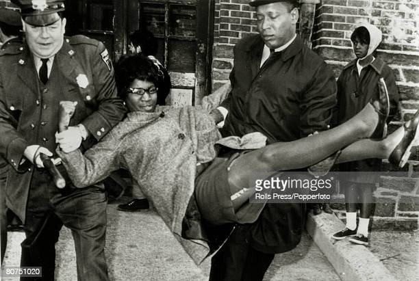 14th November 1963 Chester Pennsylvania A woman civilrights picket is hauled away after protesting about a local school which the demonstrators...