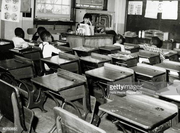 1964 Queens New York A near deserted classroom with just 5 black children attending after a massive boycott by whites after the school had been...