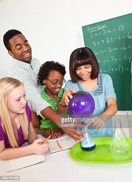 Education: Students in school science classroom. Chemistry, teacher. Experiment.